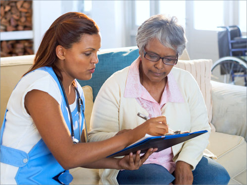 caregiver discussing with the senior woman